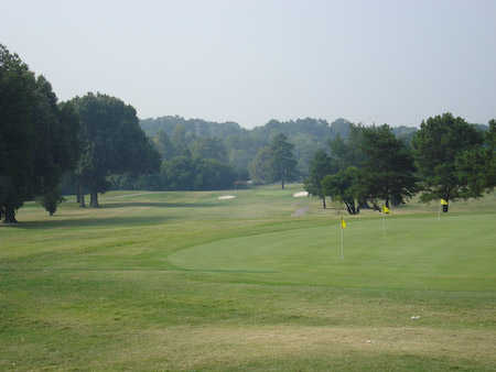 A view of a fairway and the practice area from The Links at Pine Hill