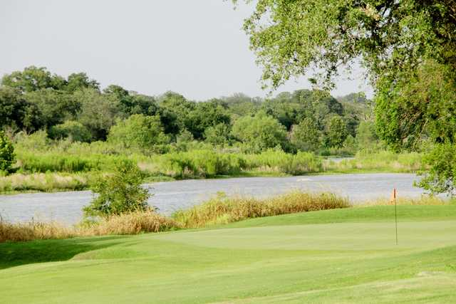 A view of a green with water coming into play at Llano River Golf Course