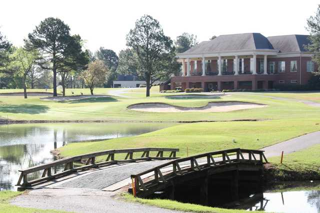 A view of a green with water and bunkers coming into play at Ridgeway Country Club