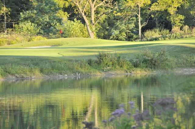 A sunny view from Huntmore Golf Club surrounded by water