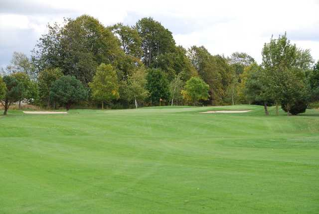 A view of a green flanked by bunkers Wander Springs Golf Course