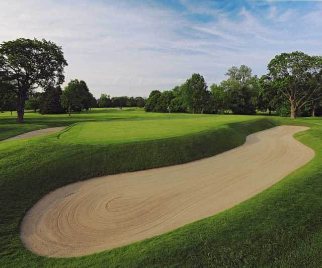 A view of green #17 protected by sand traps at Blue Mound Golf & Country Club.