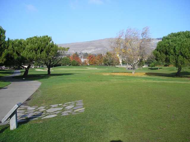 A view of a green protected by sand traps at Mission Hills of Hayward Golf Course