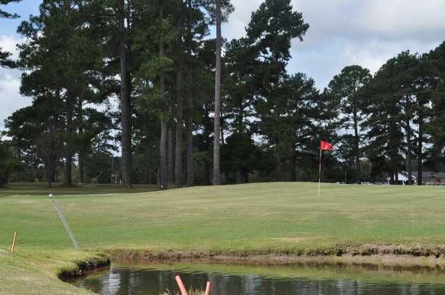 A view of a green with water coming into play at Holly Hill Golf Club