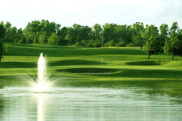 A view over the water of the 1st green at Taylor Meadows Golf Club