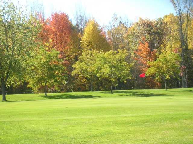 A sunny view of hole #11 at Wicker Hills Golf Course