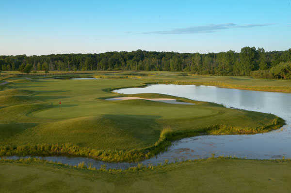 A view of a green surrounded by water at Devil's Ridge Golf Club