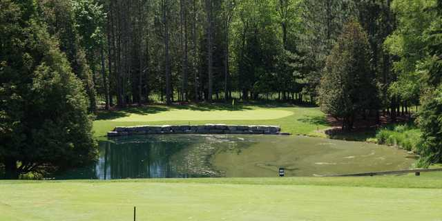A view of the 4th green with water coming into play at Legacy Pines Golf Club