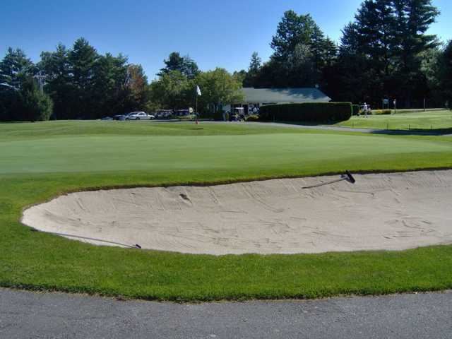 A view of a green protected by a large tricky bunker at Copley Country Club
