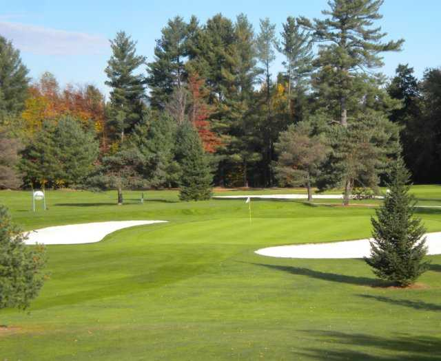 A view of the 5th hole flanked by sand traps at Copley Country Club
