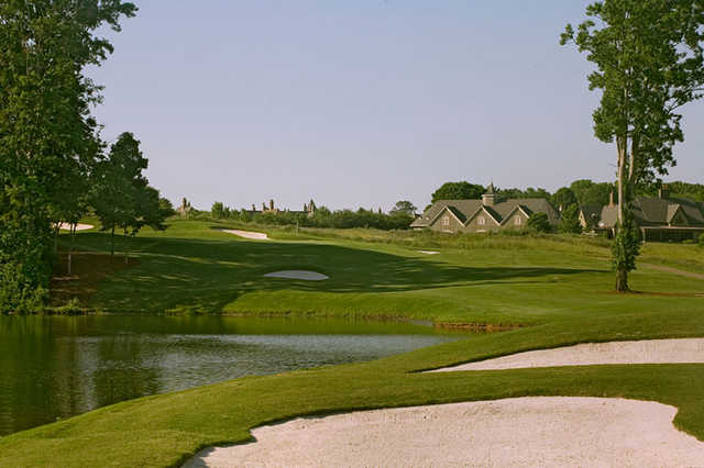A view of green surrounded by water at Barnsley Resort