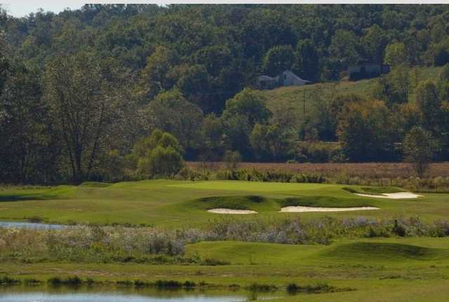 A view of a green surrounded by bunkers from Old Union Golf Course.