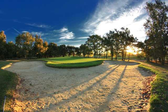 A view of a green surrounded by sand at Toulouse-La Ramee Golf Club