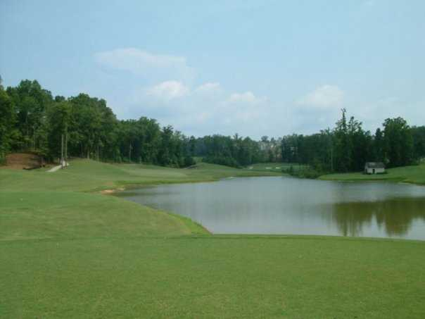 A view of green #8 surrounded by water at Chestatee Golf Club