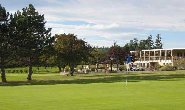 A view of a hole and the clubhouse in background at Salt Spring Island Golf and Country Club