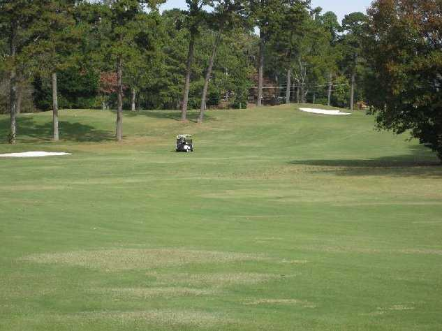 A view from hole 9th tee at Chattahoochee Golf Club with golf cart in backround