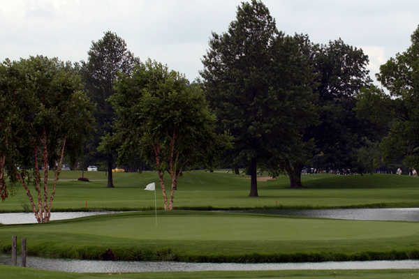 A view of a green surrounded by water at Inwood Golf Course