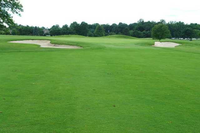 A view of green #5 flanked by sand traps at Maple Dale Country Club