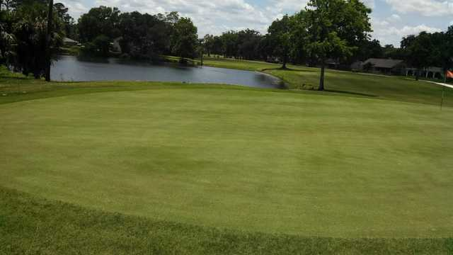 A view of a green with water coming into play at Sherwood Golf Club