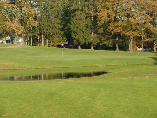 A view of the 16th green with water coming into play at Mayfair Country Club