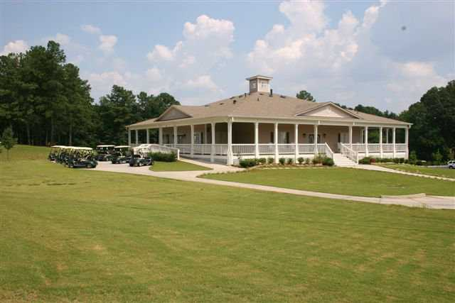 A view of the clubhouse and golf carts at Collins Hill Golf Club