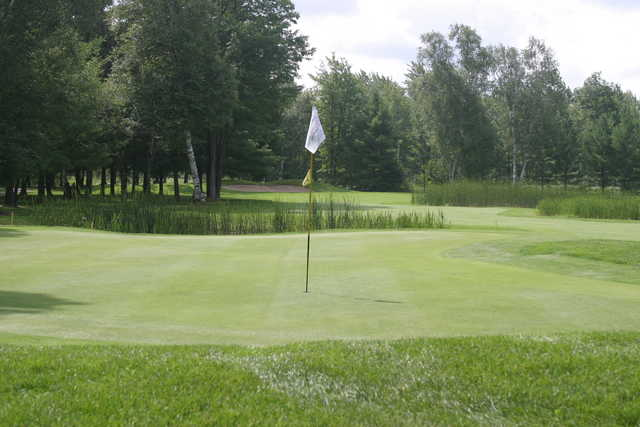 The 14th hole at the Loon Golf Resort is a tricky 304-yard par 4 over wetland
