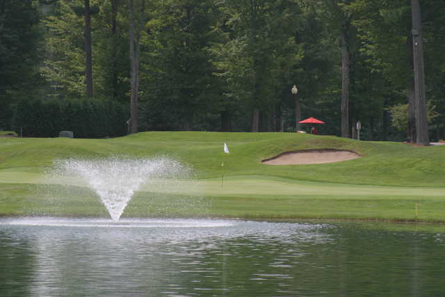The par-4 18th hole at the Loon Golf Resort requires a long approach over water to the green
