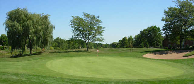 A view of a green protected by a bunker at Millcroft Golf Club.