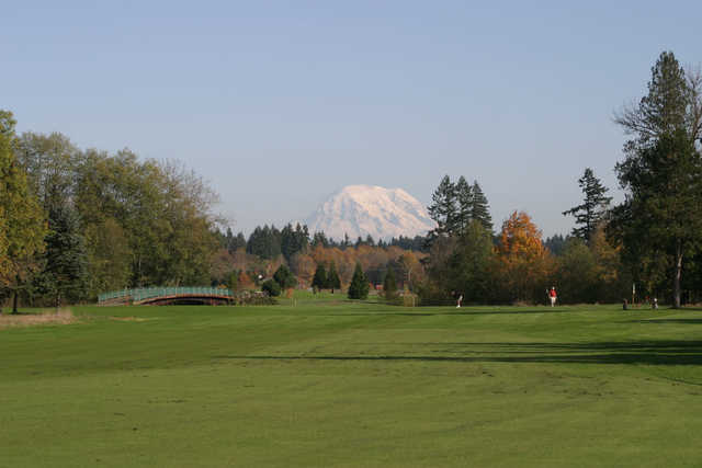 A fall view with mountain in background at Tumwater Valley Golf Club