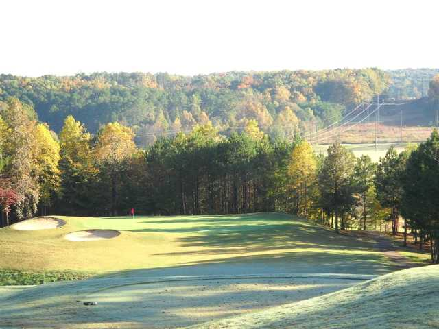 A fall view of a green protected by bynkers at Callahan Golf Links