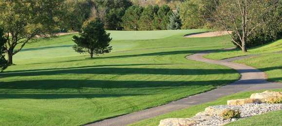 A view of a green protected by bunkers at Baraboo Country Club