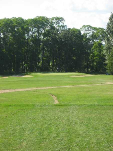 A view of a green protected by bunkers at  Blue from Coachman's Golf Resort.