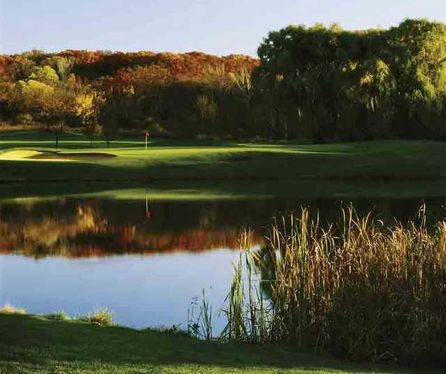 A view of a green surrounded by water at Abbey Springs Golf Course.