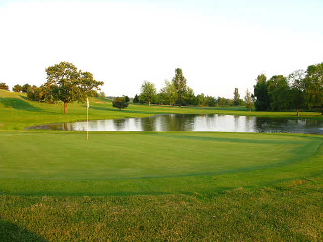 A view of a green surrounded by water at Horicon Hills Golf Club.