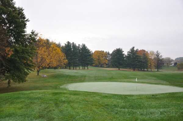 A fall view of a green at Lake Mills Golf Course