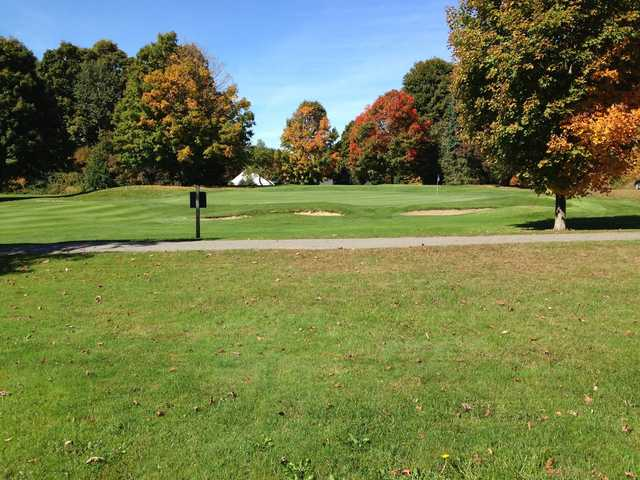 A view of a green protected by bunkers at Rendezvous Meadows Golf Course