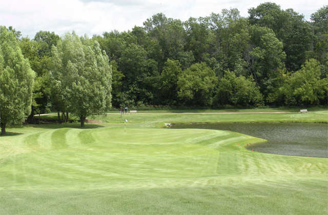 A view a of green with water coming into play from right at Mayville Golf Club