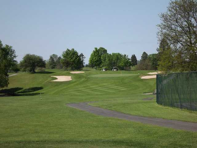 A view of a fairway and a green protected by bunkers at Hidden Valley Golf Club