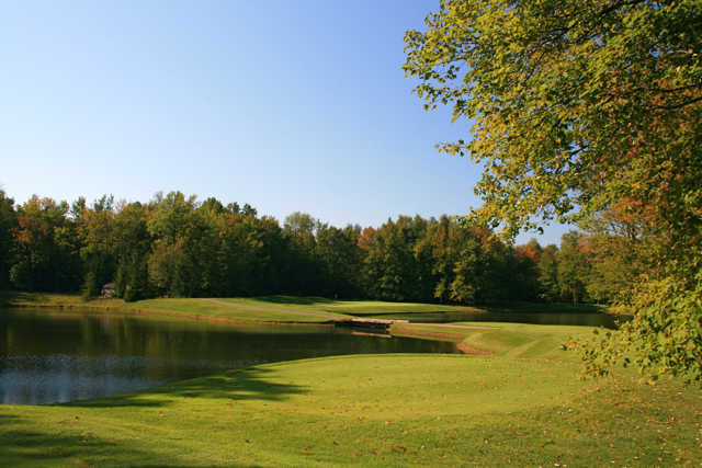 The fifth hole at Winding Hollow is a par 3 guarded by water in front and to the right
