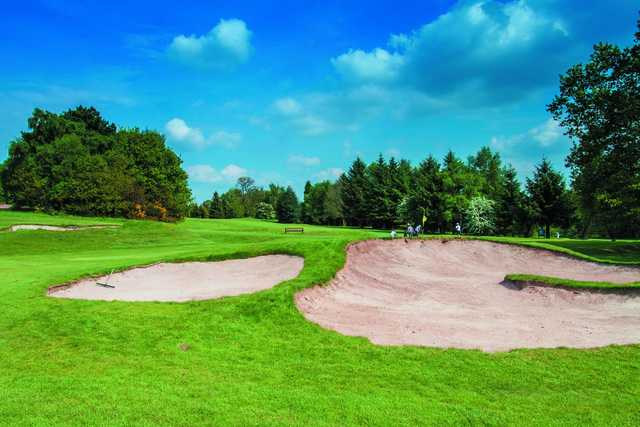 A view of a green protected by bunkers at Pype Hayes Golf Club