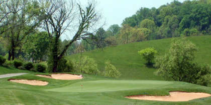 A view of green #1 protected by bunkers at Crockett Ridge Golf Course.