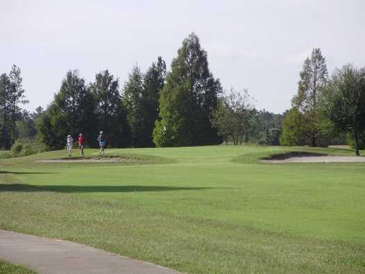 A view of a green protected by tricky bunkers at Indian Lake Estates Golf & Country Club