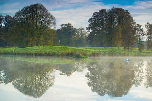 A view over the water of a green at Galgorm Castle Golf Club