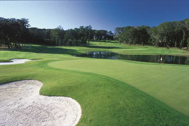 A view of a green with water and bunkers coming into play at Lake Jovita Golf & Country Club