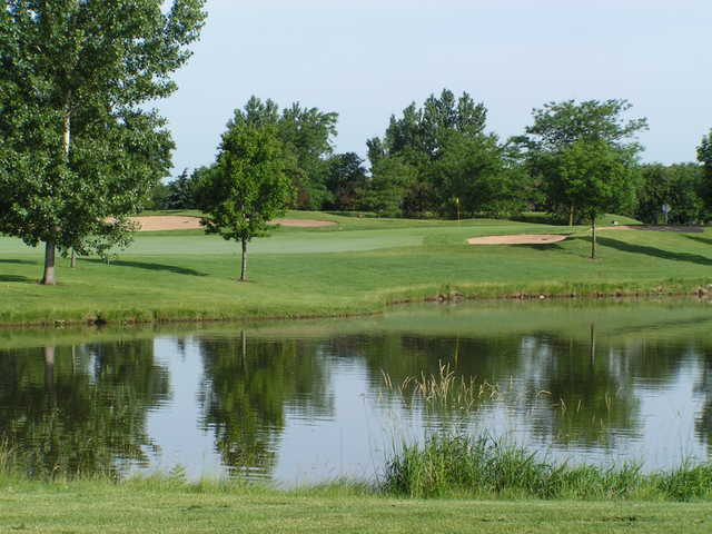 View of a hole and pond at Tamarack Golf Club