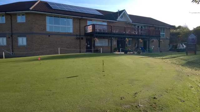The clubhouse and putting green at Ravensworth Golf Club