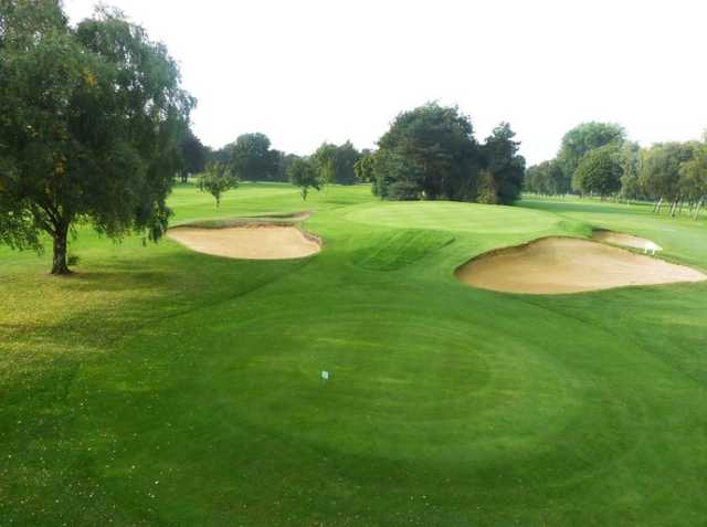 The raised 14th green at Oxley Park Golf Club with surrounding sandtraps