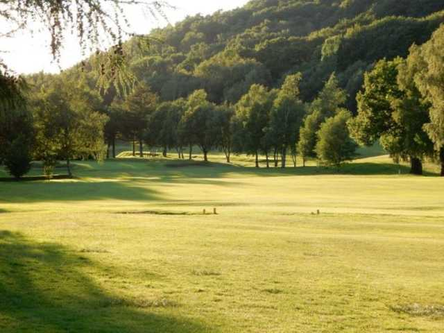 Scenic view from the fairway and the surrounding trees at Glossop & District Golf Club