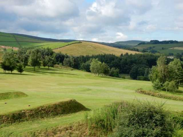 A scenic view from the course of the rolling countryside at Glossop & District Golf Club