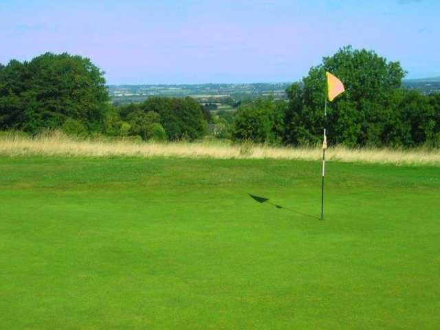 A view of the 5th green and surrounding countryside at Whiteleaf Golf Club